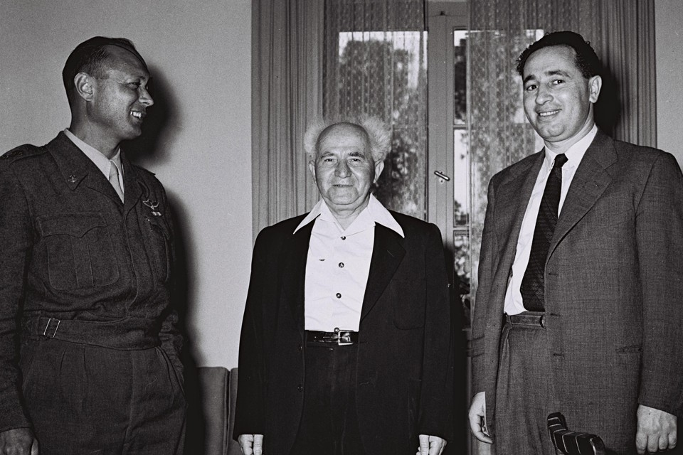 Israel's Defence Minister David Ben Gurion (C) stands with Moshe Dayan, the military's Chief of Staff, and Director General of the Ministry of Defence Shimon Peres (R) at Ministry in Tel Aviv February 2, 1955 in this handout picture released by the Israeli Government Press Office (GPO). REUTERS/Hans Pinn/GPO/Handout (ISRAEL - Tags: POLITICS) FOR EDITORIAL USE ONLY. NOT FOR SALE FOR MARKETING OR ADVERTISING CAMPAIGNS. ISRAEL OUT. NO COMMERCIAL OR EDITORIAL SALES IN ISRAEL. BLACK AND WHITE ONLY - RTR2UFUG